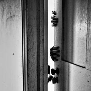 hands-on-metal-door